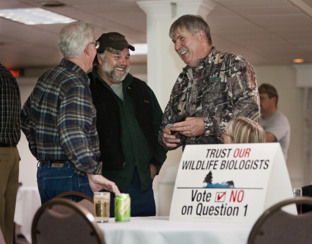 """No on 1 supporters Don Dudley of T6-R9, Jeff Bellmore of Warren and Maine Guide Bob Parker of Wilton laugh at the Black Bear Inn in Orono before the polls closed. Parker had shown a video made by his grandchildren saying, """"If we were old enough, we'd vote no on 1."""""""