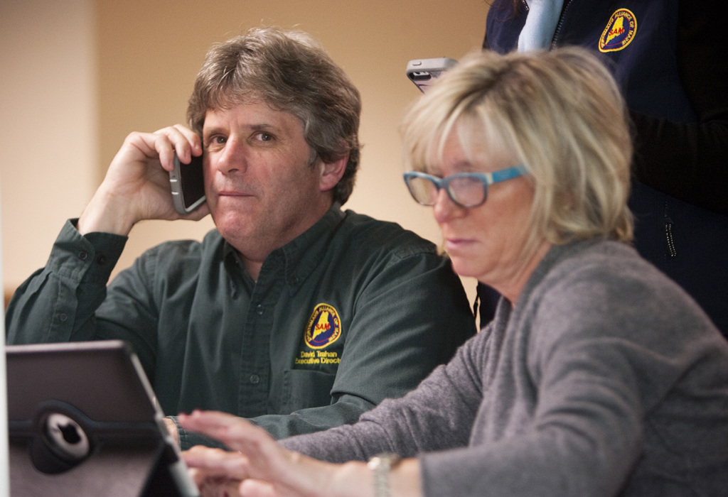 David Trahan of the Sportsman's Alliance of Maine and campaign consultant Michele MacLean of Save Maine's Bear Hunt check results at the Black Bear Inn in Orono on election night.