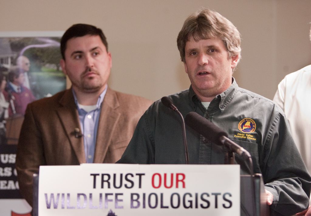 Sportsman's Alliance of Maine Executive Director David Trahan makes a victory speech for the No On 1 campaign at the Black Bear Inn in Orono on Tuesday night. Campaign manager James Cote is at left.