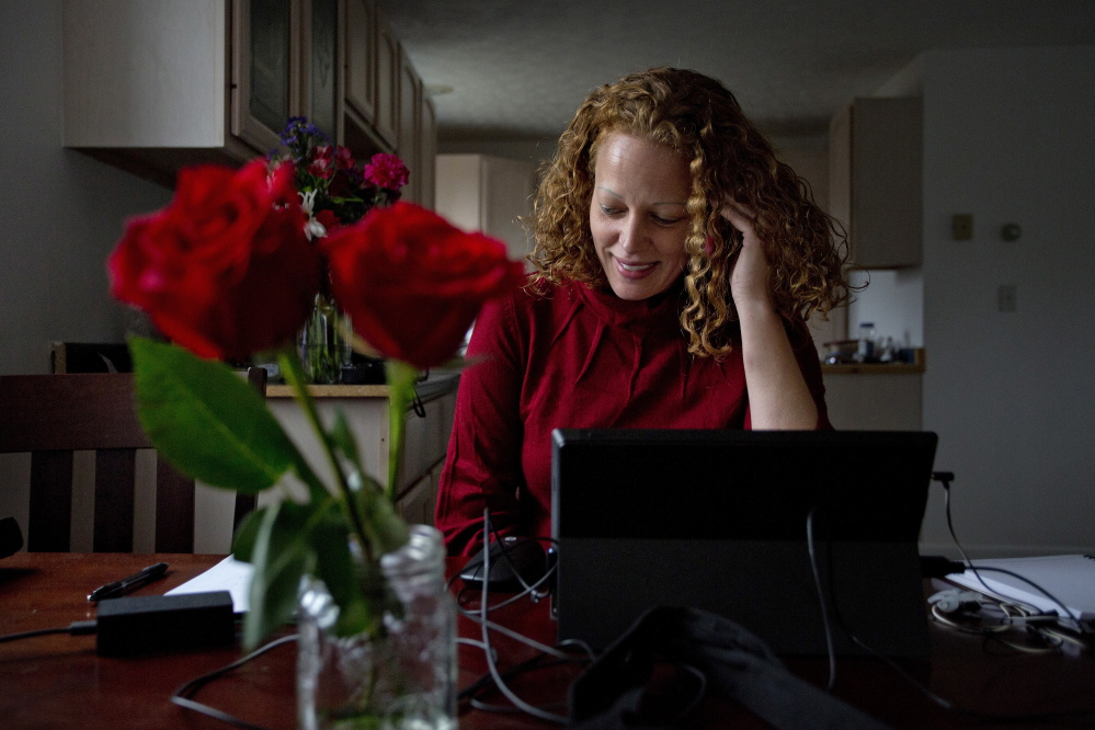 "Kaci Hickox speaks on the phone with a state health official Saturday to report that she has no symptoms of Ebola. Hickox hopes other health workers treating Ebola patients will be treated better than she has been. ""I know that won't happen today,"" she said."