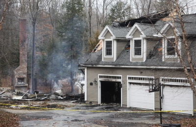 The State Fire Marshal's Office is investigating the cause of the fire that destroyed this house at 12 Inverness Road in Falmouth late Saturday. Jill Brady/Staff Photographer