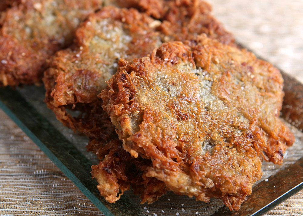 ... potato pancakes, are prepared by frying grated potato and onions
