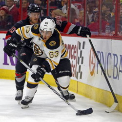 Boston Bruins' Brad Marchand battles with Carolina's Riley Nash in Sunday's game at Raleigh, N.C. The Hurricanes won 2-1 in a shootout.