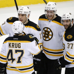 Boston's Patrice Bergeron (37) celebrates his overtime goal against the Pittsburgh Penguins on Wednesday night in Pittsburgh. The Bruins won, 3-2, to end a three-game losing streak.