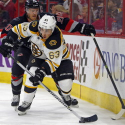 Given his history, Boston Bruins winger Brad Marchand, shown stickhandling against the Carolina Hurricanes, might be lucky that he drew only a two-game suspension for an infraction against the New York Rangers last Thursday. Marchand has been suspended on two other occasions for illegal hits.