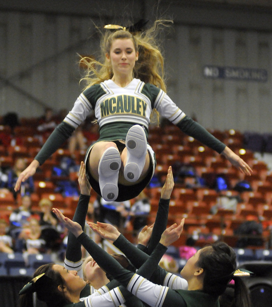 Catherine McAuley High School competes during the regional cheerleading championships Monday. Andy Molloy /Kennebec Journal