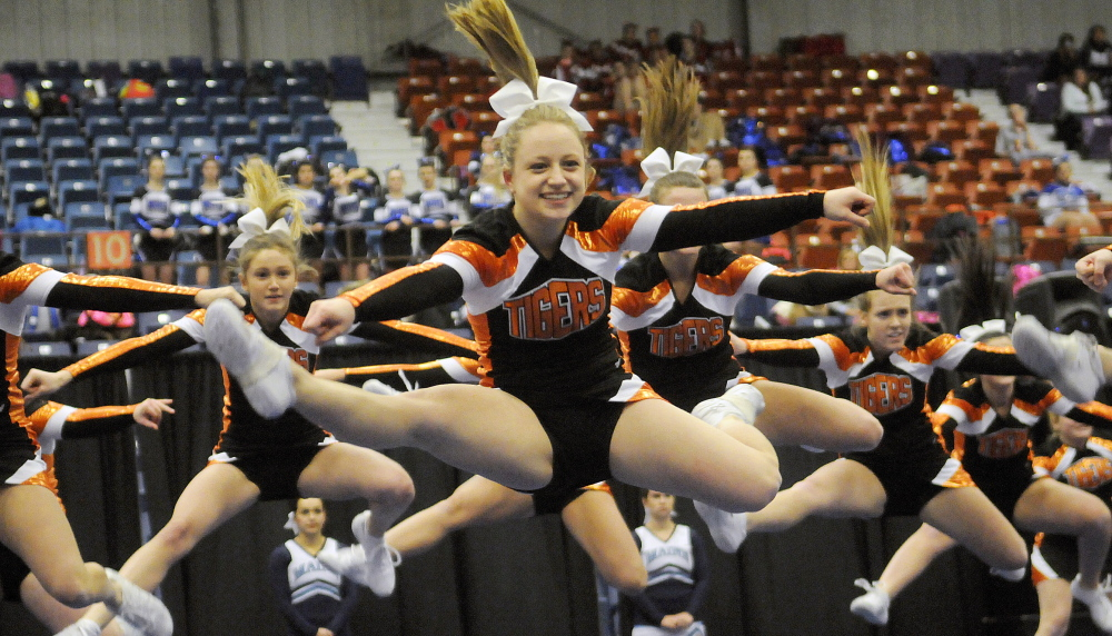 Biddeford performs the routine that earned it a second-place finish at the Western A regionals Monday at the Augusta Civic Center. Gorham won the regional title with a score of 146.2, followed by the Tigers with 144.2. Andy Molloy/Kennebec Journal
