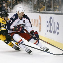 :Boston's Chris Kelly battles the Blue Jackets' Brandon Dubinsky for the puck behind the net during Saturday's game in Boston, won 3-1 by the Blue Jackets. The Associated Press