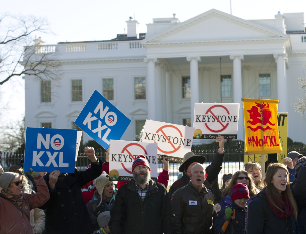 Dozens of demonstrators rally in January outside the White House in support of Obama's pledge to veto any legislation approving the Keystone XL pipeline. Congress Wednesday gave approval that would expedite the pipeline.