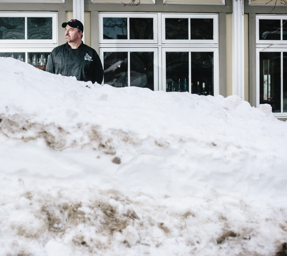 This winter's frequent storms have been tough on dining establishments such as The Front Room at 73 Congress St. in Portland, one of four restaurants owned by Harding Smith, outside The Front Room above. Snowbanks and parking bans have kept customers away, Smith said.