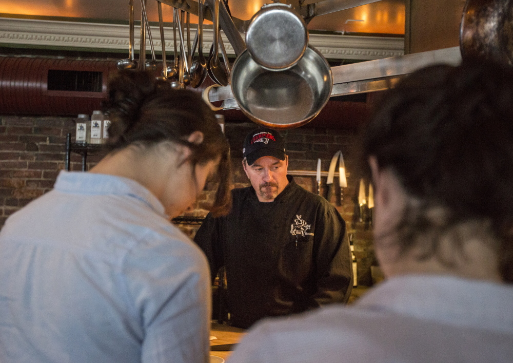 The Front Room chef and owner Harding Smith speaks to his staff before dinner service Wednesday. On Valentine's Day, Smith said business was down at least 40 percent because forecasts calling for a blizzard alarmed customers. Only 2.3 inches fell in Portland.