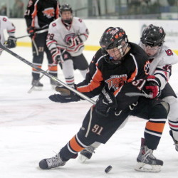 Biddeford's Ricky Ruck tries to fend off Scarborough's Sean McDonald. Gabe Souza/Staff Photographer