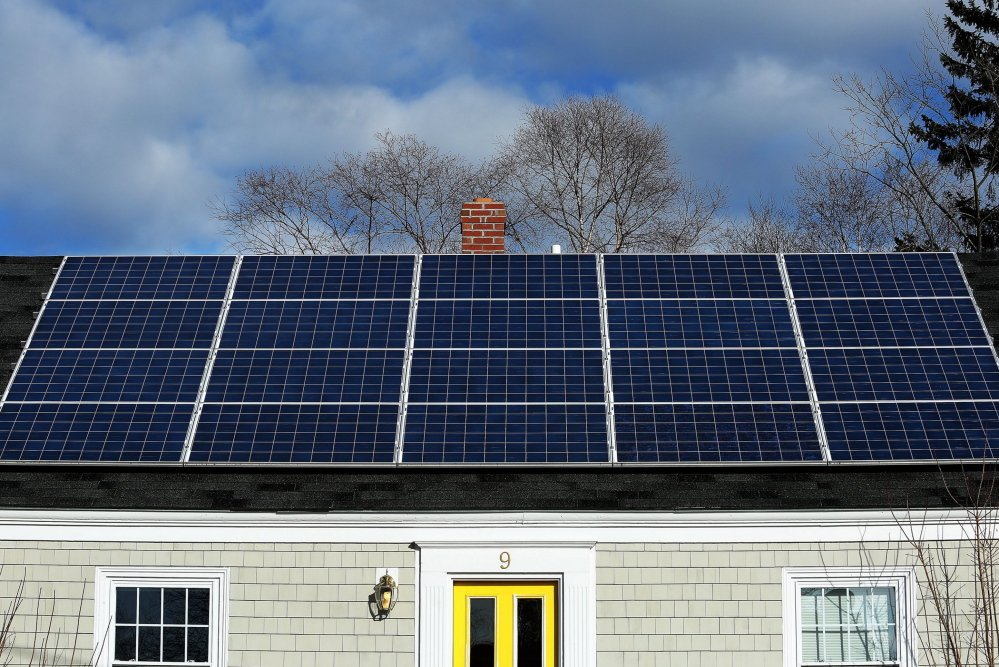 A solar panel array gathers sunlight on the roof of a house on Lynda Road in Portland. In Freeport, 70 residents have signed up to get their properties evaluated and price quotes under a bulk-discount solar panel program.