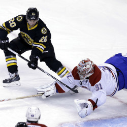 Bruins left wing Daniel Paille, left, and Montreal goalie Carey Price vie for control of the puck during the first period of the Canadiens' 3-1 win Sunday in Boston. The Associated Press