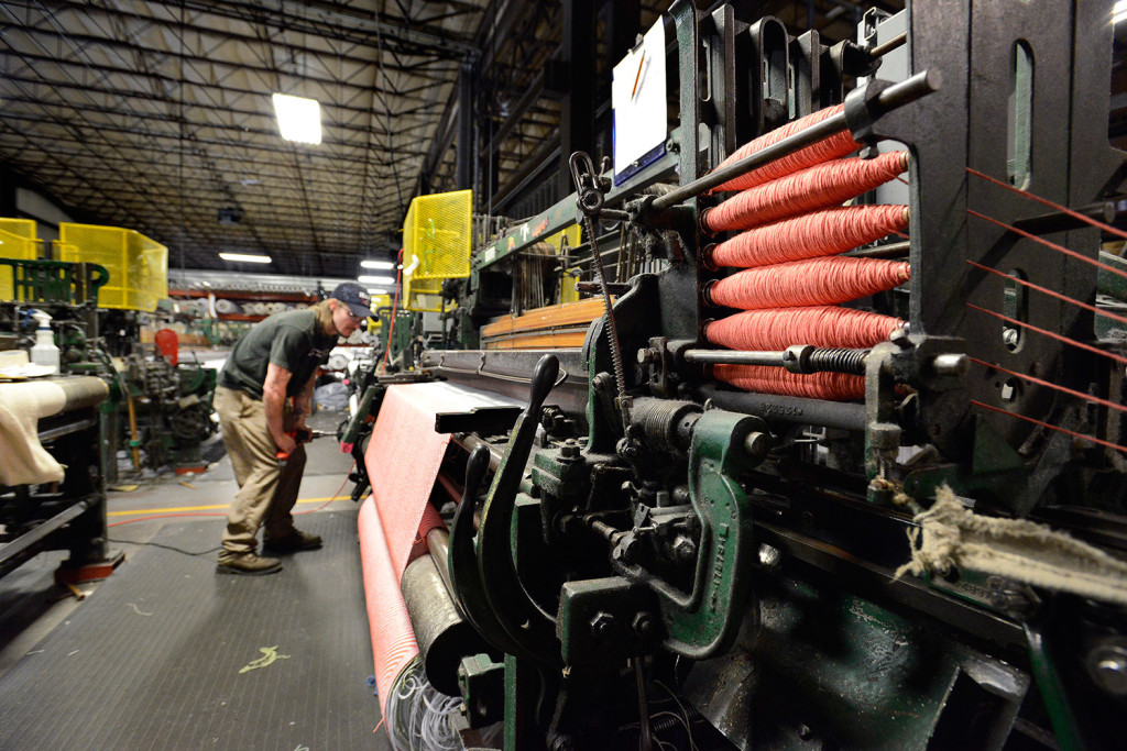 Loom operator Bryan McFadden keeps a eye on making a throw blanket at Brahm's Mount Mill.