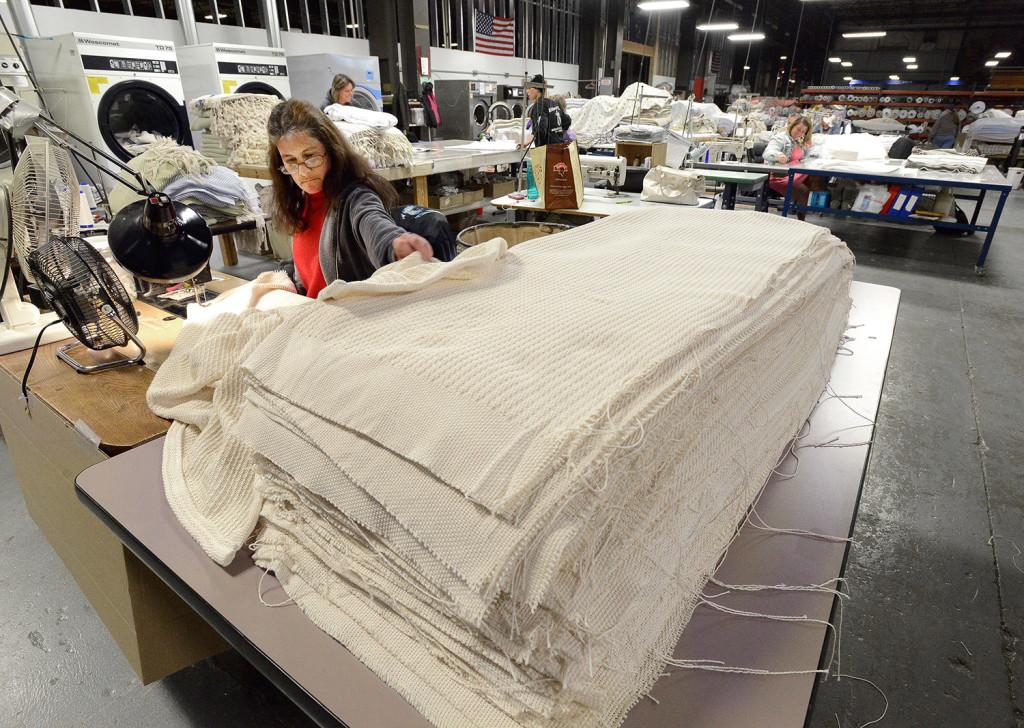 Stitcher Brenda Hodgkin works on baby blankets at Brahm's Mount Mill.