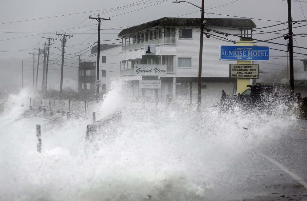 Derek Davis/Staff Photographer:  Waves crash over a sea wall along Long Beach Avenue in York, Monday, Oct. 29, 2012, as a result of weather conditions from Hurricane Sandy.