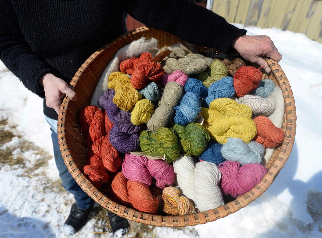 A basket of naturally dyed local alpaca wool at Lana Plantae Farm.