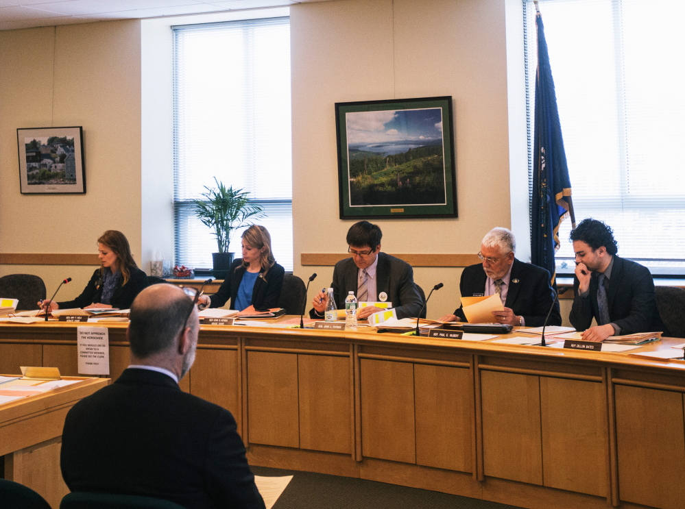 The Legislature's Labor, Commerce, Research and Economic Development Committee meets in Augusta on April 2. None of the 13 lawmakers who serve on the panel has a background in banking, accounting or investing.