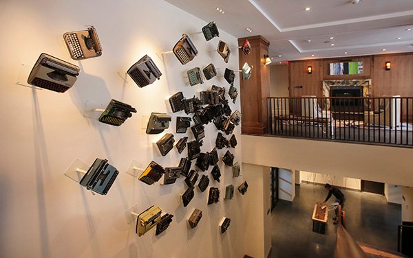 Old typewriters are mounted to a wall in the main lobby area of The Press Hotel in Portland, shown here on May 4, 2015. Developer Jim Brady has branded the history of the Portland Press Herald and newspaper journalism throughout the hotel, which is housed in the former Press Herald building.