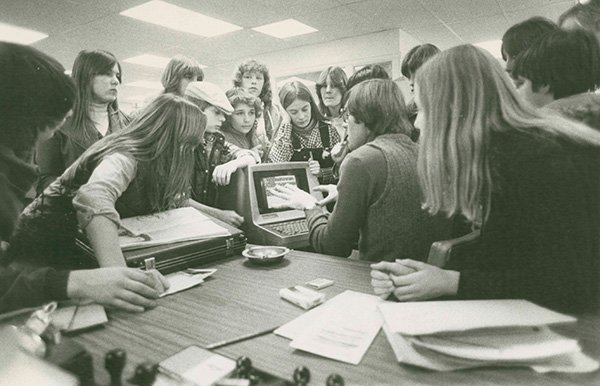 Reporter George Weir speaks to newsroom visitors in 1978 on the second floor at the old Portland Press Herald building on Exchange Street.