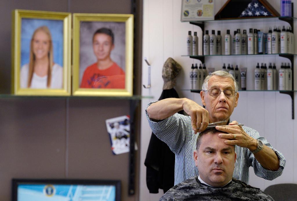 Barber Shop Portland Maine : Chretien, who runs Rogers Barber Shop on Main Street, works on Cline ...