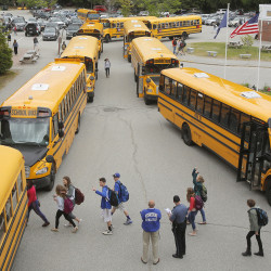 Students walk to their respective buses at dismissal at Kennebunk High School on Wednesday. Gregory Rec/Staff Photographer
