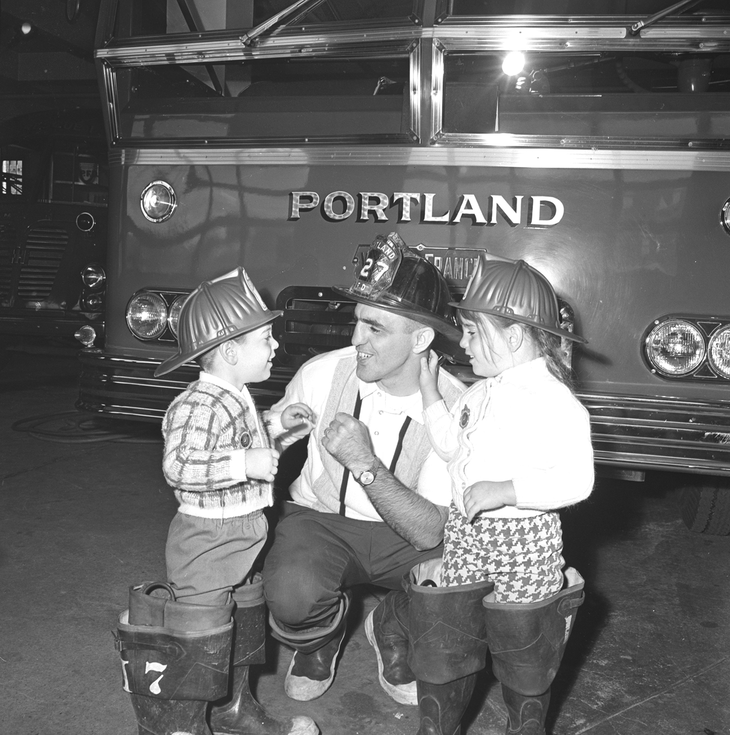 Portland Fire Department firefighter with children and fire engine, 1968. From the Portland Public Library archival collection of Portland Press Herald, Maine Sunday Telegram and Evening Express photos.