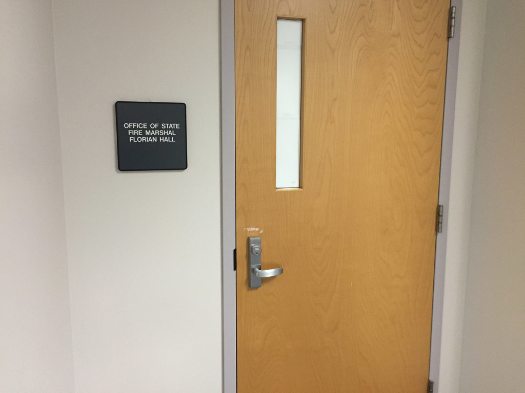 With Wednesday's drug summit closed to the public, the window of the door to the meeting room was papered over. Photo by Steve Mistler/Staff Writer