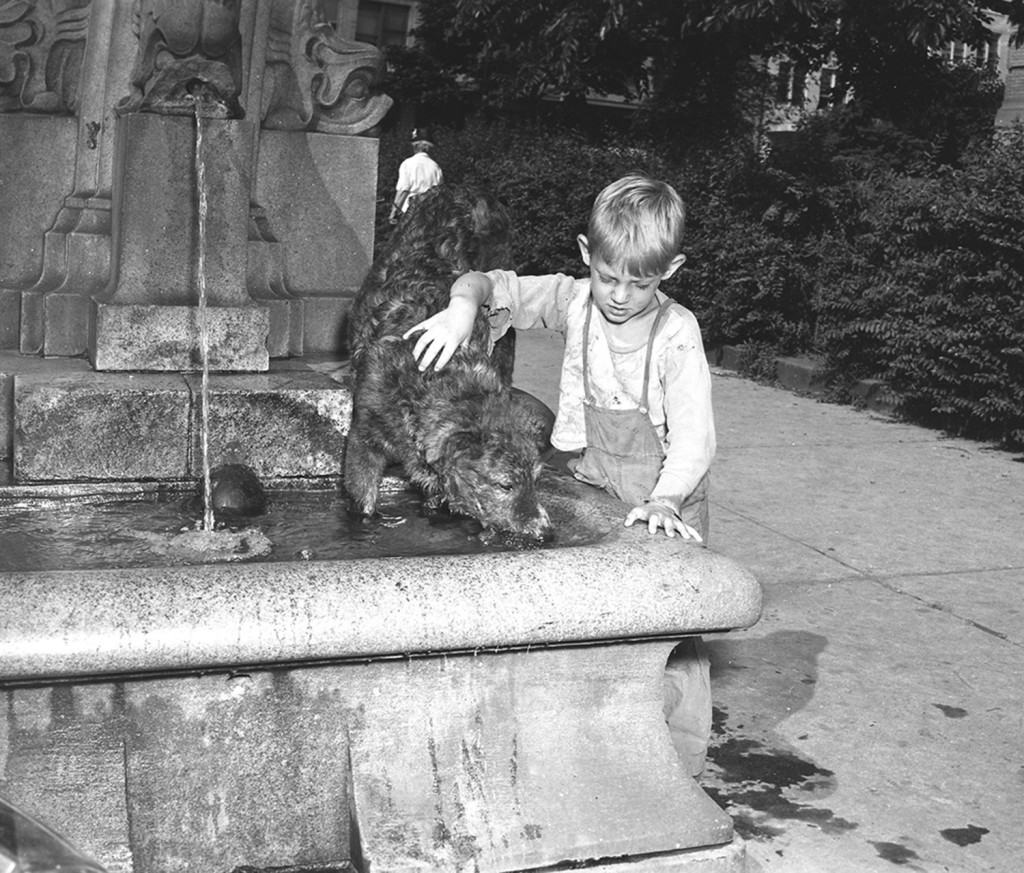 Freddy Collins with his dog Tippy, at the Pullen Fountain, Federal Street, July, 22, 1948. From the Portland Public Library archival collection of Portland Press Herald, Maine Sunday Telegram and Evening Express photos.