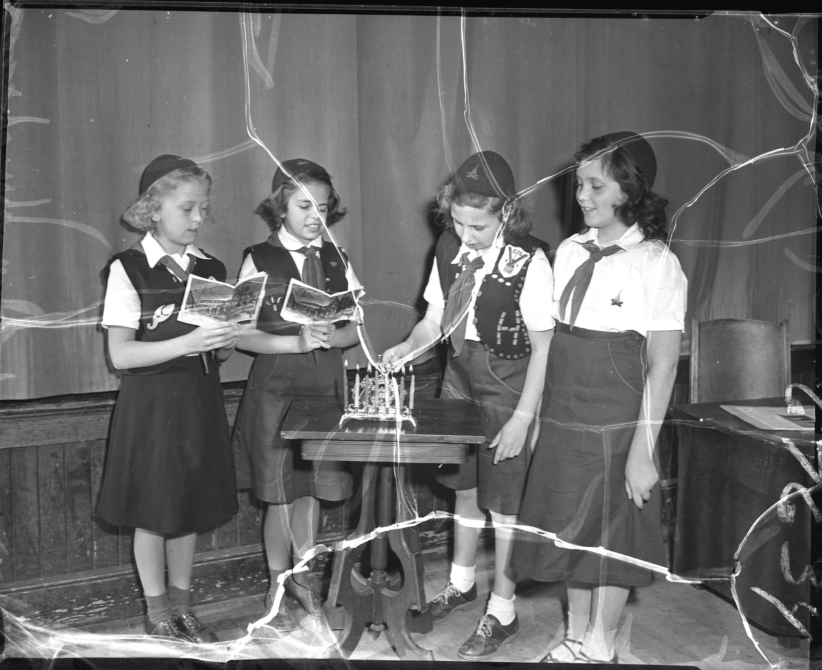 Girls light a menorah, 1951. From the Portland Public Library archival collection of Portland Press Herald, Maine Sunday Telegram and Evening Express photos.