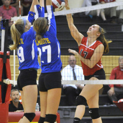Lydia Farmer, left, and Caroline DeNoia of Falmouth block a scoring bid by Haley Nelson of Scarborough during Scarborough's victory Tuesday night.