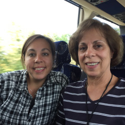 """Lauren Stone of Westbrook and Lorraine Auclair of Greenville, daughter and mother, ride the bus Friday on their way to see Pope Francis this weekend in Philadelphia. """"Everything is so mean and scary in the world,"""" Stone said, """"and Pope Francis is so kind and caring."""""""