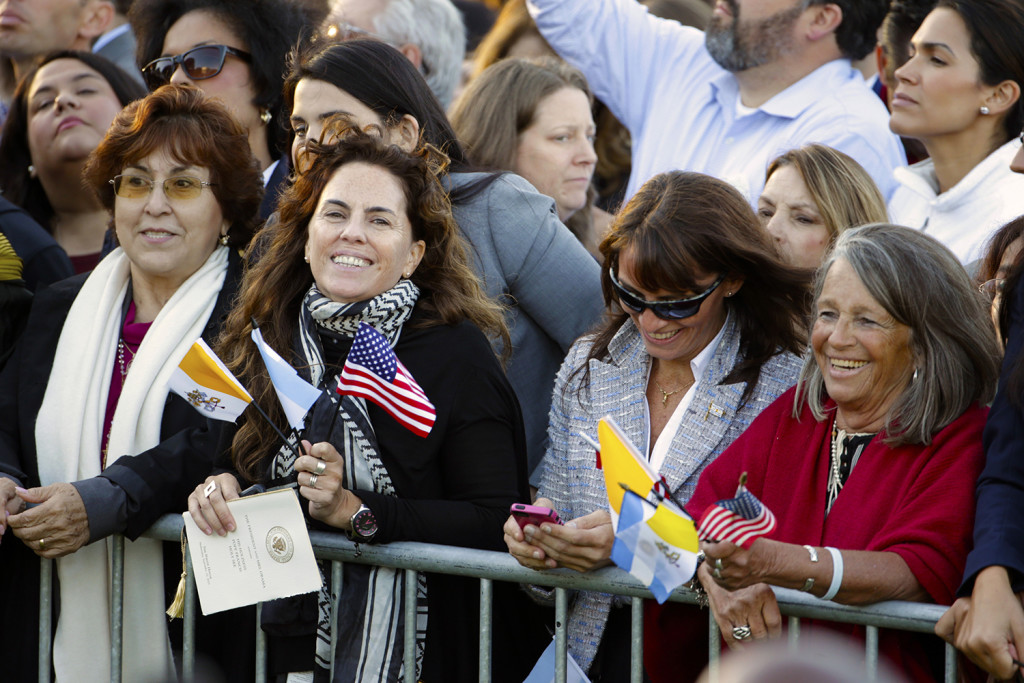 Spectators hoping for a glimpse of Pope Francis crowd the South Lawn of the White House in Washington, Wednesday, before the official state arrival ceremony where President Barack Obama will welcome the pope. The Associated Press