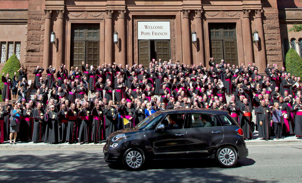 Pope Francis leaves the Cathedral of St. Matthew the Apostle in his Fiat 500 after a midday prayer service in Washington on Wednesday, as bishops applaud.