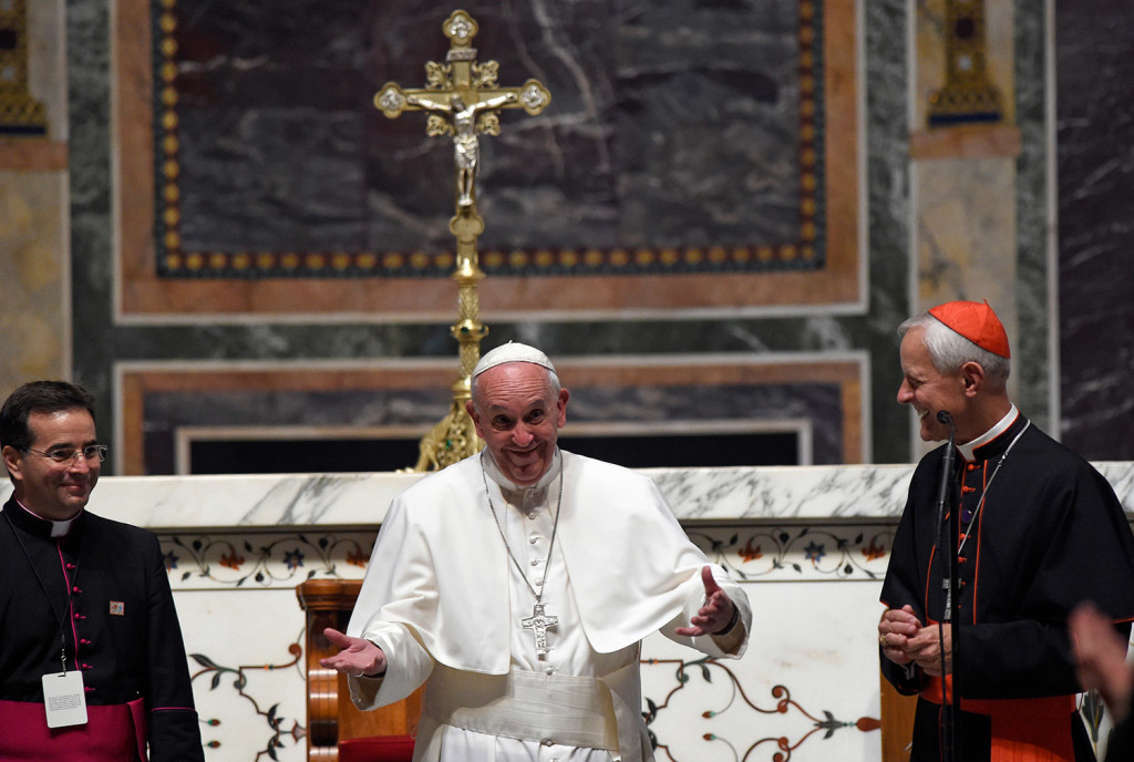 Pope Francis stands with Cardinal Donald Wuerl, archbishop of Washington, right, as the pontiff expresses his disappointment that he can't stay longer to greet everyone following the Midday Prayer from the Liturgy of Hours, the daily form of prayer of the Catholic Church, with bishops from the United States on Wednesday at the Cathedral of St. Matthew the Apostle in Washington.