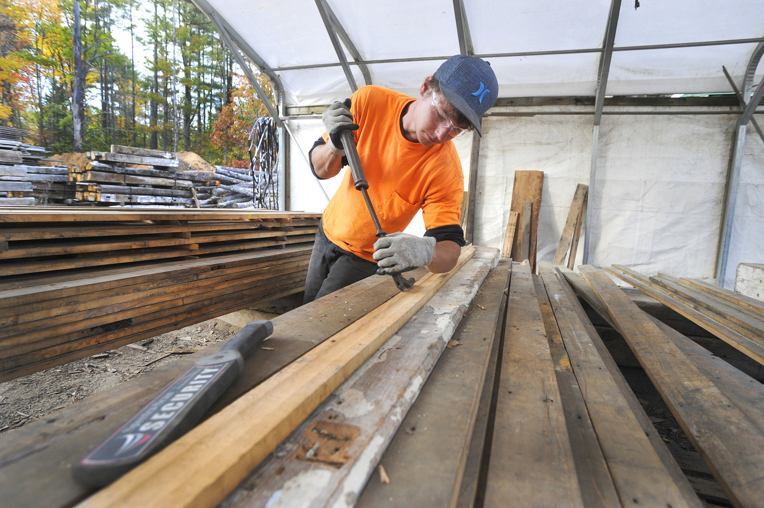 Reclaiming wood the portland press herald maine sunday for Reclaimed flooring portland