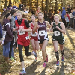 Anna Slager of Gorham, 46, prepares to emerge from the lead pack and claim the Class A cross country championship Saturday. Challenging were, left to right, Katherine Leckbee of Mt. Ararat, Serena McKenzie of South Portland and Kialeigh Marston of Bonny Eagle.