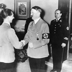 1937: German Chancellor Adolf Hitler, right, congratulates Dr. Joseph Goebbels on his 40th birthday at the ministry of propaganda and public enlightenment in Berlin.