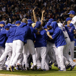 The Cubs celebrate their four-game victory over the St. Louis Cardinals in the National League Division Series on Tuesday night in Chicago.