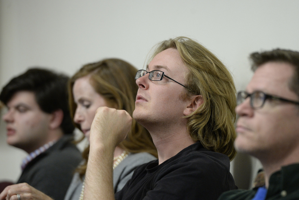 Mako Bates, one of the Green activists who supports raising the minimum wage, watches for results at Portland City Hall on Tuesday. Shawn Patrick Ouellette/Staff Photographer