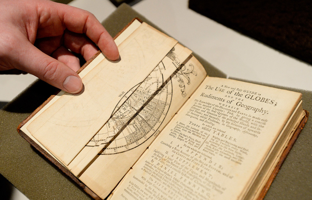 """A New and Easy Guide to the Use of the Globes"" by Daniel Fenning, a book from 1785, will be digitized along with a collection of globes at the Osher Map Library."
