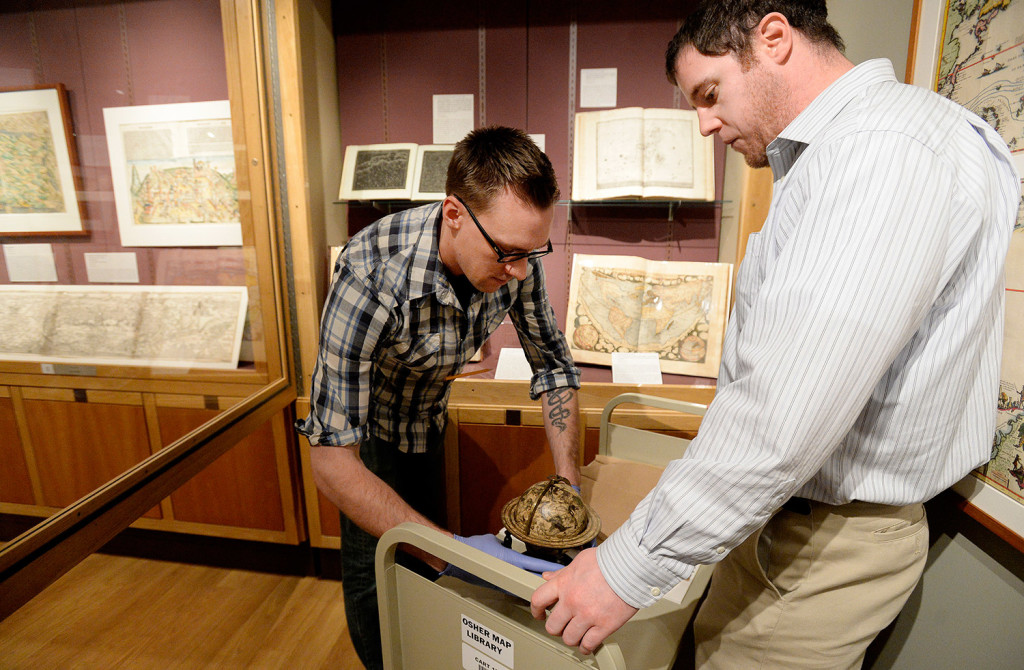David Neikirk, digital imaging coordinator, left, and Ian Foller, director at Osher Map Library and Smith Center, prepare a 1607 William Blaeu celestial globe for its photo shoot.