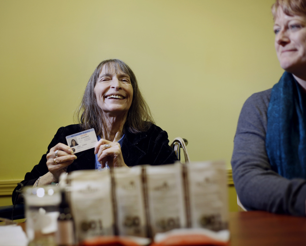 Linda Horan, a New Hampshire resident with end-stage lung cancer, talks to the media after purchasing medical marijuana products at Wellness Connection in Portland on Friday.