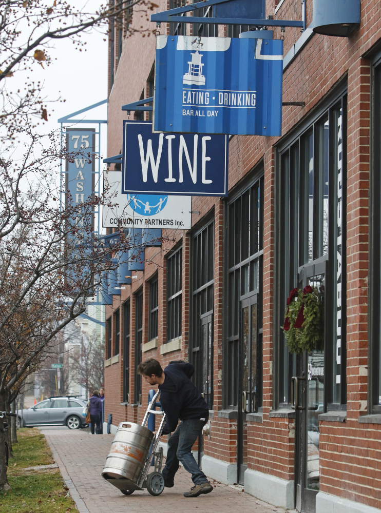 A delivery arrives at the Maine & Loire wine shop, which offers wine and tastings a short distance from the Roustabout and Terlingua restaurants along Washington Avenue.