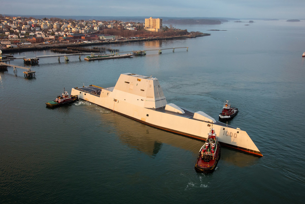 Tugboats turn the Zumwalt as it arrives unannounced in Portland Harbor in December during sea trials. <em>Photo by Dave Cleaveland Maineimaging.com </em>