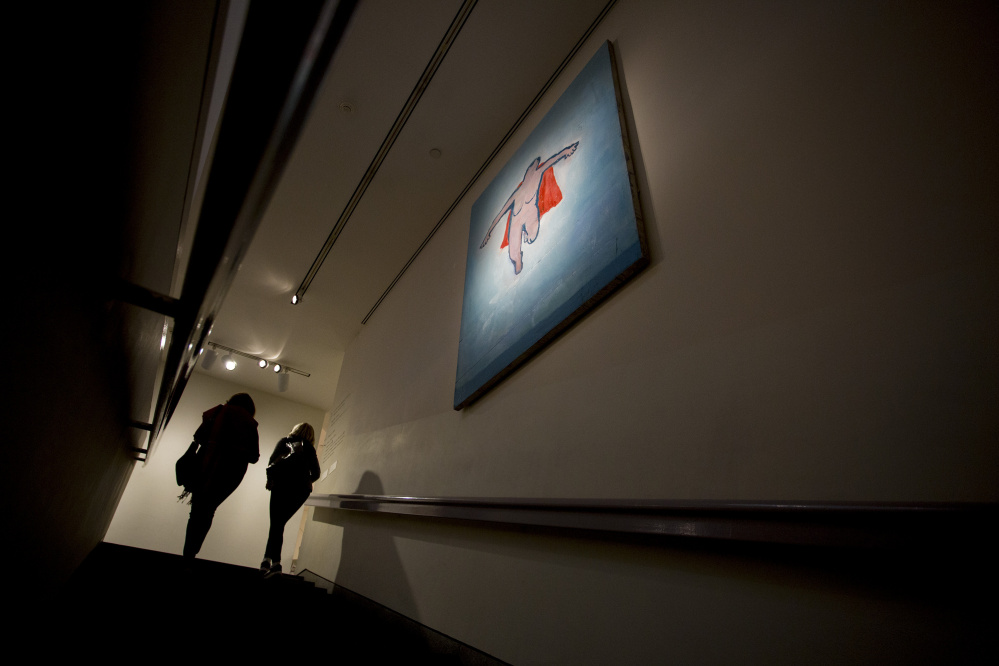 "PORTLAND, ME - DECEMBER 10: Portland Museum of Art visitors walk past ""Woman Flying"" a piece by Katherine Bradford, (cq) in the stairway from the cafe to the Great Hall Thursday, December 10, 2015. The museum is set to close for three weeks in January to clean up and reinstall some galleries like the Langlais piece. (Photo by Gabe Souza/Staff Photographer)"