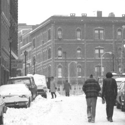 Pedestrians walk up Exchange Street toward Middle Street after a snowstorm in this Portland Evening Express photograph from December 1977.