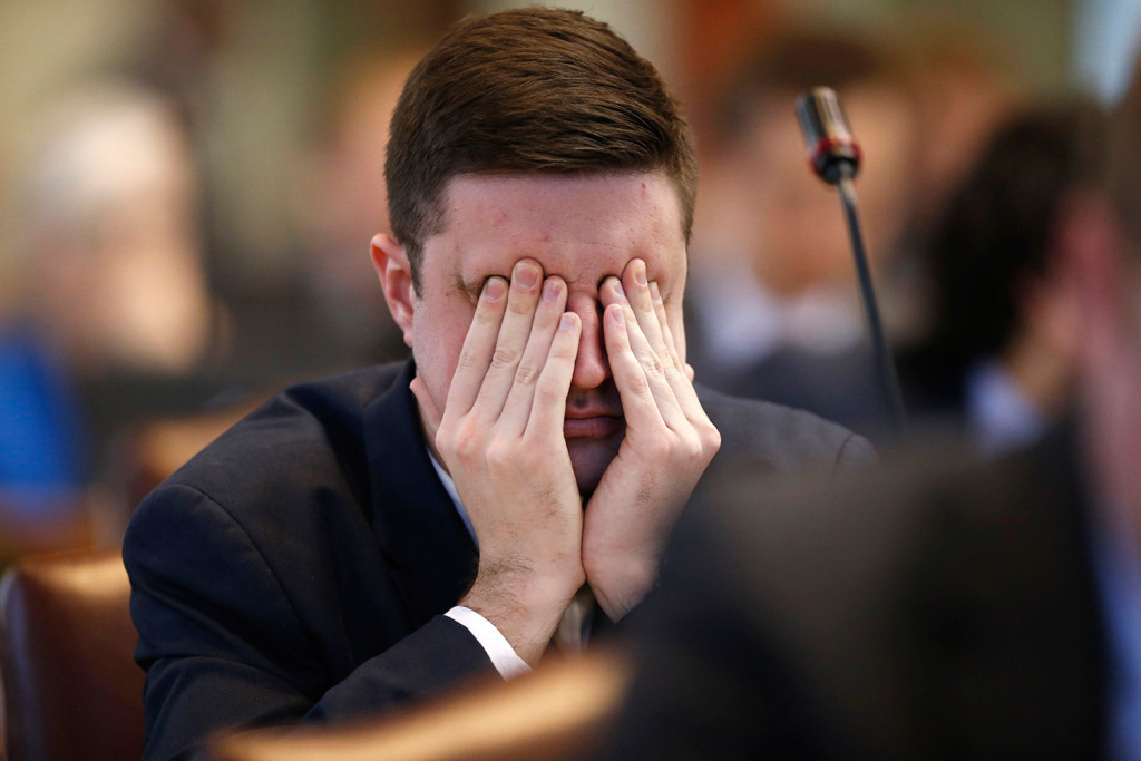 State Rep. Henry Beck, D-Waterville, rubs his eyes during a debate on an order to impeach Gov. Paul LePage on Thursday at the State House in Augusta.
