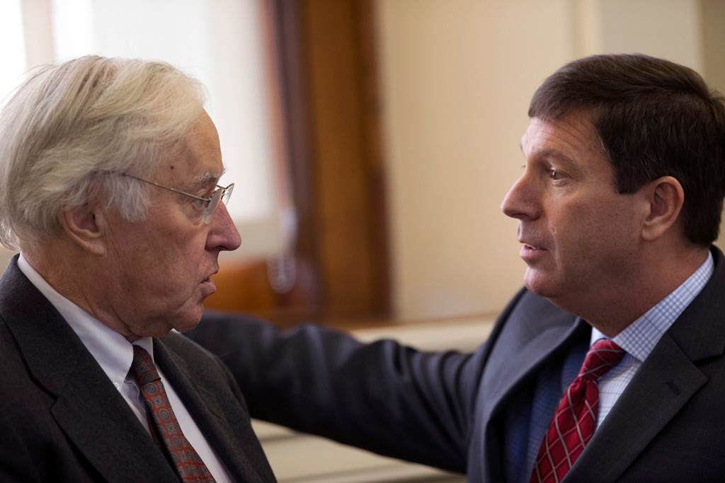 House minority leader Ken Fredette, R-Newport, right, speaks with State Rep. John Martin, D-Eagle Lake, prior to debate on an order to impeach Gov. Paul LePage on Thursday at the State House in Augusta.